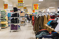 Customers search for bargains at the soon to be closing Sears store in Rego Park in the New York borough of the Queens on Saturday, February 18, 2017. Sears Holdings has deemed the store unprofitable and it will be closing sometime in April. The store is one of the 42 stores they will close in the spring. Sears is also closing 108 Kmart stores. (© Richard B. Levine)
