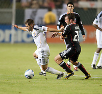 CARSON, CA – SEPTEMBER 18:  LA Galaxy midfielder Dema Kovalenko (21) and DC United midfielder Stephen King (25) during a soccer match at Home Depot Center, September 18, 2010 in Carson California. Final score LA Galaxy 2, DC United 1.