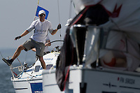 Simon Shaw, sailing for Ian Williams of Great Britain  prepares to drop the spinnaker during the quarter finals of Match Race Germany 2010. World Match Racing Tour. Langenargen, Germany. 23 May 2010. Photo: Gareth Cooke/Subzero Images/WMRT