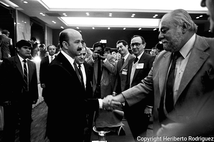 Archive photo of former Mexican President Carlos Salinas de Gortari (L) shaking hands with  right-wing leader Manuel Clouthier during a meeting with the Mexican Employers' Association or Confederacion Patronal de la Republica Mexicana (COPARMEX) on March 1989. Photo by Heriberto Rodriguez