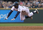 Seattle Mariners' James Jones dives head first into third base after hitting  a triple to center field in the third inning September 13, 2014 at Safeco Field in Seattle.   UPI/Jim Bryant