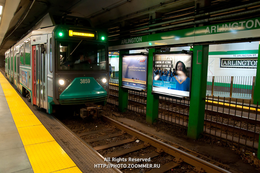 Green line Arlington station in Boston with tram (train) coming in