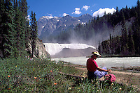 Yoho National Park, Canadian Rockies, BC, British Columbia, Canada - Hiker resting beside Wapta Falls, Kicking Horse River, Summer (Model Released)