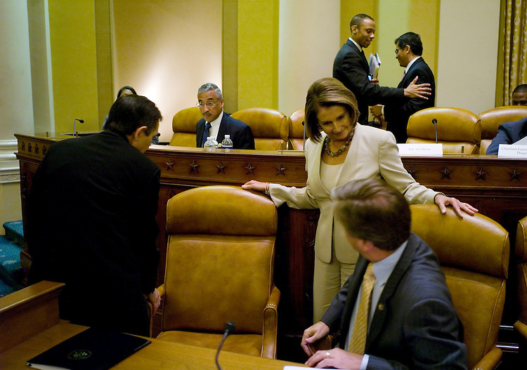 WASHINGTON, DC - Sept. 15: Rep. Dennis J. Kucinich, D-Ohio, and Rep. John F. Tierney, D-Mass., move their chairs out of the way as House Speaker Nancy Pelosi, D-Calif., makes her way past them during a break in the Democratic Steering & Policy Committee forum on health insurance reform. (Photo by Scott J. Ferrell/Congressional Quarterly)
