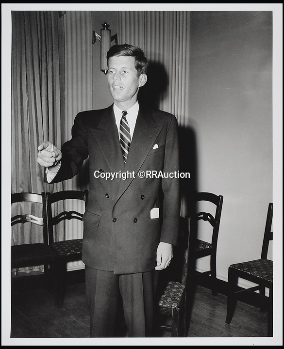 BNPS.co.uk (01202 558833)<br /> Pic: RRAuction/BNPS<br /> <br /> Kennedy practicing his oration skills in his Beacon Hill apartment in 1948.<br /> <br /> Incredibly-rare photos highlighting the first foray into politics for John F. Kennedy that would eventually cost him his life have come to light.<br /> <br /> The 100 black and white snaps show a youthful-looking JFK from 1946, when he was campaigning to become a US congressman for the first time.<br /> <br /> The tragic future president is seen during an oration lesson where he was given help by an expert with public speaking and posture.<br /> <br /> The 29-year-old is also depicted mingling with the public at an annual parade and as well as celebrating his first political victory - a congressional primary vote - in June 1946.<br /> <br /> The images are being sold by US-based RR Auction.