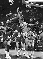 Oakland Oaks Doug Moe is fouled against the Kentucky Colonels..ABA game (1969 photo/Ron Riesterer)