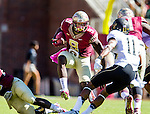 Personal Work<br /> <br /> Karlos Williams leaps a fallen teammate to confront Wake Forest safety Anthony Wooding, Jr. as Florida State defeated Wake Forest 43-3 in an NCAA football game in Tallahassee, FL October 4, 2014.