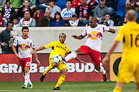 Jamison Olave (4) of the New York Red Bulls and Federico Higuain (33) of the Columbus Crew. The New York Red Bulls and the Columbus Crew played to a 2-2 tie during a Major League Soccer (MLS) match at Red Bull Arena in Harrison, NJ, on May 26, 2013.
