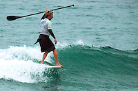 Saturday, June 14, 2008, Tourmaline Surf Park, Pacific Beach, San Diego, CA, USA.  Jerry Swearingen hangs five during the Stand-Up Paddle semi-finals of the Pacific Beach Surf Club's Tenth Annual Longboard Classic at Tourmaline Surfing Park.  Its the first year that SUP has been included in the competition.  The event was well attended despite gray, June gloom clouds and fickle, windy surf conditions.