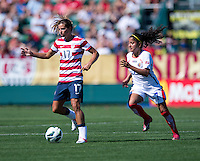 Tobin Heath (17) of the USWNT keeps the ball away from Mariela Campos (7) of Costa Rica during a friendly match at Sahlen's Stadium in Rochester, NY.  The USWNT defeated Costa Rica, 8-0.
