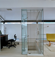 A sunken bath and shower separates the two office spaces off the main bedroom