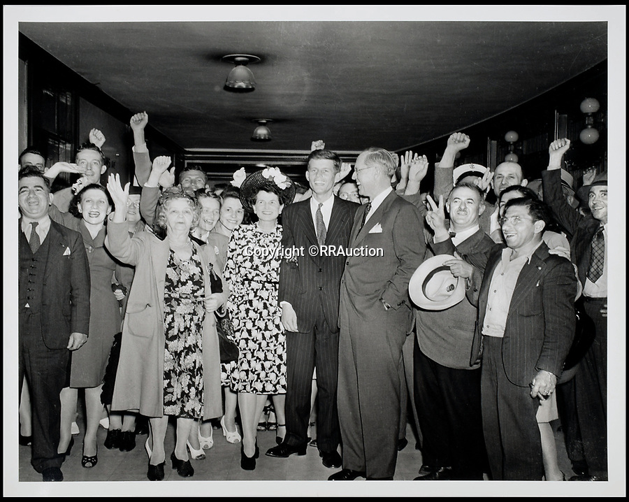 BNPS.co.uk (01202 558833)<br /> Pic: RRAuction/BNPS<br /> <br /> John, Joe Sr., and Rose Kennedy in 1946 Celebrating Primary Victory on the Congressional Campaign.<br /> <br /> Incredibly-rare photos highlighting the first foray into politics for John F. Kennedy that would eventually cost him his life have come to light.<br /> <br /> The 100 black and white snaps show a youthful-looking JFK from 1946, when he was campaigning to become a US congressman for the first time.<br /> <br /> The tragic future president is seen during an oration lesson where he was given help by an expert with public speaking and posture.<br /> <br /> The 29-year-old is also depicted mingling with the public at an annual parade and as well as celebrating his first political victory - a congressional primary vote - in June 1946.<br /> <br /> The images are being sold by US-based RR Auction.