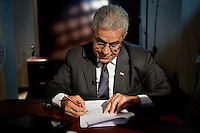 Hamdeen Sabahi in his office at his headquarter. .Egyptian presidential candidate Hamdeen Sabahi is greeted by  supporters during the Labour Day protest in Cairo..Hamdeen Sabahi is from the Karama Party, which has a Nasserist orientation. Seen as a leftist, the Sabbahi campaign platform involves the immediate implementation of social welfare programs. He aims to enhance Egypt?s position as a regional powerhouse, support the Palestinian cause with more vigor, promising to end Egypt?s role in the Gaza siege, and encourage cooperation with Iran and Turkey to decrease American influence in local politics.
