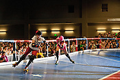 Jammers race around the track during a bout between Putas del Fuego and Hellcats at Palmer Events Center in Austin, Texas.