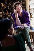 The Guardian reporter Zoe Williams (center in purple) interviews a group of teenaged mothers and child brides in Bhaishahi village, Bardia, Western Nepal, on 29th June 2012. In Bardia, StC works with the district health office to build the capacity of female community health workers who are on the frontline of health service provision like ante-natal and post-natal care, and working together against child marriage and teenage pregnancy especially in rural areas. Photo by Suzanne Lee for Save The Children UK