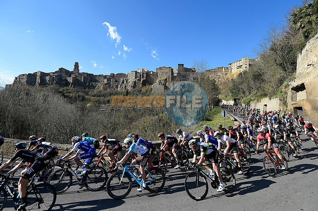 The peloton pass some stunning hilltop villages during Stage 3 of the 2017 Tirreno Adriatico running 204km from Monterotondo Marittimo to Montalto di Castro, Italy. 10th March 2017.<br /> Picture: La Presse/Fabio Ferrari | Cyclefile<br /> <br /> <br /> All photos usage must carry mandatory copyright credit (&copy; Cyclefile | La Presse)