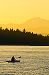 Woman kayaking on Lake Almanor, near Mount Lassen, Northern California.