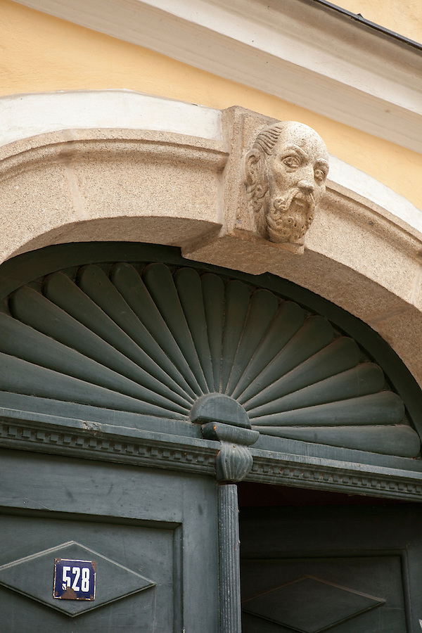 Carved sculpture over doorway, southern Bohemia, Czech Republic, Europe