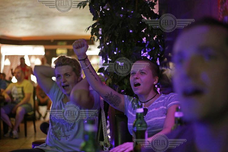 Polish football fans watch their national team playing in the Euro 2016 tournament on television in a town centre pub. <br /> The town of Boston had the country's highest proportion of 'leave' votes cast in the EU referendum with almost 76 percent of ballots cast for Brexit. Lincolnshire has, in recent years, seen an influx of EU workers drawn to the area's agricultural industry. The 2011 census found about 13 percent of Boston's residents were born in Eastern Europe and migrated to the UK since 2004.