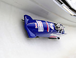 22 November 2009:  John James Jackson, piloting the Great Britain bobsled, leads his 4-man team to a 21st place finish at the FIBT World Cup competition, in Lake Placid, New York, USA. Mandatory Credit: Ed Wolfstein Photo