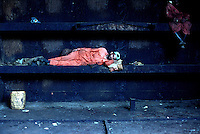 A worker takes a nap while working inside a ship's hull at the Gaddani ship-breaking yard.