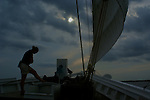 Dark clouds shroud the A J Meerwald sailing in the Delaware Bay.