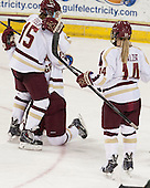 Emily Field (BC - 15), Andie Anastos (BC - 23), Emily Pfalzer (BC - 14) - The Boston College Eagles defeated the visiting University of Vermont Catamounts 2-0 on Saturday, January 18, 2014, at Kelley Rink in Conte Forum in Chestnut Hill, Massachusetts.