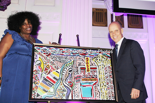 Scott Hamilton is honored tonight with artwork by young lady - Figure Skating in Harlem celebrates 20 years - Champions in Life benefit Gala on May 2, 2017 in New York Ciry, New York.   (Photo by Sue Coflin/Max Photos)