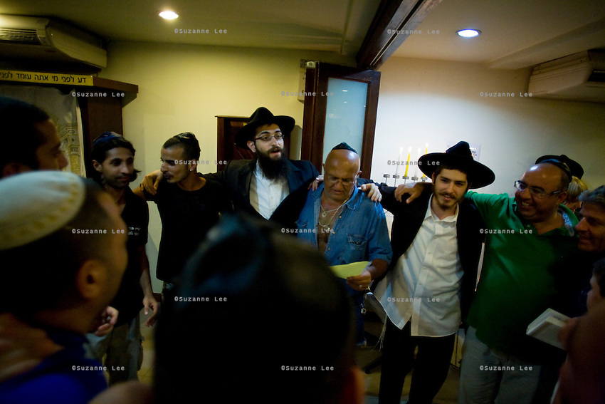 Jewish travellers and residents of the popular Thai tourist island of Koh Samui gather to sing and light candles in the Chabad House of Koh Samui with Rabbi Goldshmid (center, left) during Chanuka celebrations on 17th December 2009. .Koh Samui is the smaller of 2 islands next to each other, world renowned for the monthly full moon rave parties on the beach..Photo by Suzanne Lee / For Chabad Lubavitch