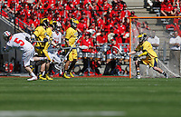 Ohio State's Turner Evans (5) scores a goal past Michigan's goalie Robbie Zonino (28) in the second quarter of the NCAA lacrosse game between the Ohio State Buckeyes and Michigan Wolverines at Ohio Stadium in Columbus, Saturday morning, April 12, 2014. The Ohio State Buckeyes defeated the Michigan Wolverines 15 - 6. (The Columbus Dispatch / Eamon Queeney)