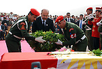 CHAMCHAMAL, IRAQ: Kurdish Prime Minister Barham Salih lays a wreath during the funeral ceremony of 104 Kurds discovered in a mass grave...On April 15, 2010, Iraqi Kurds held a ceremony to honor the 102 children and 2 pregnant women discovered in a mass grave near the town of Dibis.  They are believed to have been killed in the 1988 Anfal genocidal campaign against Iraq's Kurds.