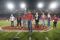 STANFORD, CA-- October 5, 2013: Eight new members of Stanford University Athletic Hall of Fame were introduced at halftime of Stanford's football game against Washington Saturday evening.<br /> <br /> Those inducted are Lauren Fleshman &rsquo;03 (women&rsquo;s track &amp; field), Jeffrey Hammonds &rsquo;92 (baseball), Keith Jones &rsquo;84 (men&rsquo;s basketball), Glyn Milburn &rsquo;92 (football), Anthony Mosse &rsquo;88 (men&rsquo;s swimming), Olympia Scott &rsquo;98 (women&rsquo;s basketball), Logan Tom &rsquo;03 (women&rsquo;s volleyball) and Brenda Villa &rsquo;03 (women&rsquo;s water polo).<br /> during the Stanford vs Washington game Saturday night at Stanford Stadium.<br /> <br /> Stanford won 31-28.