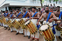 Udduku (drums from Kerala) players during Pulikali festival, Trichur, Kerala, India..Pulikali or Kaduvvakali is a two hundred year old folk dance form, practised mostly in Thrissur and Palghat districts of Kerala. It liberally makes use of forms and symbols of nature that finds expression in its bright, bold body painting and high-energy dance movements. The philosophy of Pulikali is that human and nature are integral parts of each other. So by fusing man and beast in its artistic language, it flamboyantly celebrates the connection. Arindam Mukherjee