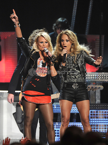 LAS VEGAS, NV - MAY 18: 5 Carrie Underwood (R) and Miranda Lambert perform on the 2014 Billboard Music Awards at the MGM Grand Garden Arena on Sunday, May 18, 2014 in Las Vegas, Nevada. PGMicelotta/MediaPunch