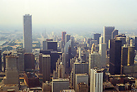 """Chicago: Panorama from Hancock looking south. Note the """"tiny"""" Carbide and Carbon Building, center. Compare height and mass to Amoco Tower, left. Just  peaking out is the Wrigley Building. Photo '88."""