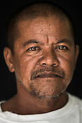 64 year old Tuna fisherman, Juanito Pina poses for a portrait at the Casa, the Tuna buying house in Puerto Princesa, Palawan in the Philippines. <br /> Photo: Sanjit Das/Panos for Greenpeace