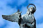 The statue of La Virgen de Quito overlooks the city from the El Panecillo in Quito, Ecuador.
