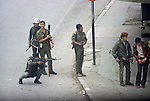 Nablus West Bank Israel. Israeli soldier shoots at rioting Palestinians ( out of frame.) The Palestinian man in the brown jacket is arrested. 1980s Middle East