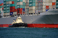 Tug guiding large container ship. <br />