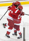 Victoria Pittens (Cornell - 14), Erin Barley-Maloney (Cornell - 22) - The Boston College Eagles defeated the visiting Cornell University Big Red 4-3 (OT) on Sunday, January 11, 2012, at Kelley Rink in Conte Forum in Chestnut Hill, Massachusetts.