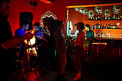 Guests chill out at The Zoo, a funky nightclub located in the south of New Delhi, India. Photograph: Sanjit Das/Panos