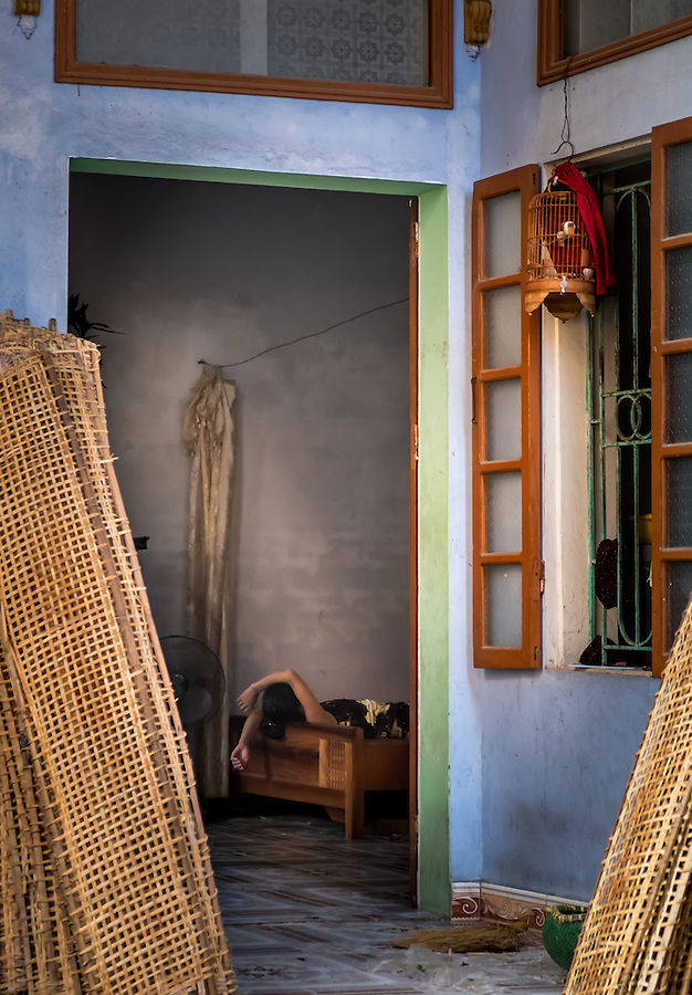 VAN HA, VIETNAM - CIRCA SEPTEMBER 2014:  Woman taking a nap inside her house at the Lang Gom Tho Ha village. The village belongs to the Van Ha commune, it is located 50km away from Hanoi in Northern Vietman