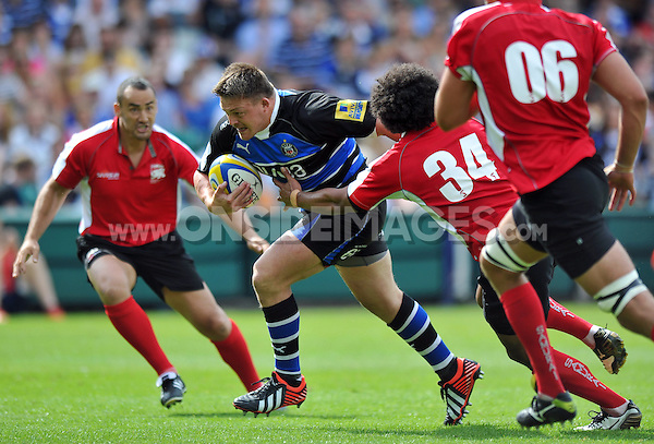 David Wilson breaks through the London Welsh defence. Pre-season friendly match, between Bath Rugby and London Welsh on August 11, 2012 at the Recreation Ground in Bath, England. Photo by: Patrick Khachfe / Onside Images
