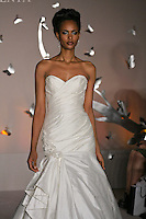 Model walks runway in an Alvina Valenta Fall 2011 dress by Jessica Williams, for the JLM Couture Fall 2011 Bridal fashion show.