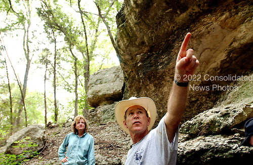 United States President George W. Bush tours a canyon with White House Staff Secretary Harriet Miers at his ranch in Crawford, Texas, Friday, August  9, 2002. <br /> Mandatory Credit: Eric Draper - White House via CNP