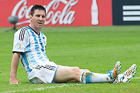 Lionel Messi of Argentina sits on the grass