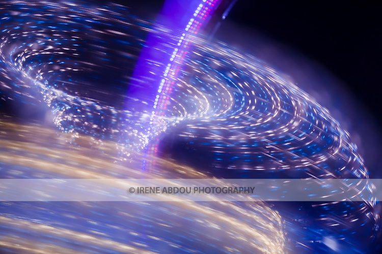 "A photography technique called ""focus blur"" is used to transform the lights of a spinning carnival ride into abstract designs at the Montgomery County Agricultural Fair in Gaithersburg, Maryland."