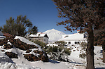 Properties below snow capped Mount Teide, Tenerife, Canary Islands.