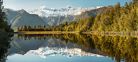 Stunning morning winter reflections of Mount Tasman and  Aoraki, Mount Cook of Southern Alps in Lake Matheson, Westland Tai Poutini National Park, West Coast, UNESCO World Heritage Area, South Westland, New Zealand, NZ