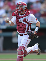 NWA Democrat-Gazette/ANDY SHUPE<br />Arkansas catcher Grant Koch runs the ball to third base to tag out one of two Georgia baserunners stationed at the bag Saturday, April 15, 2017, during the fourth inning at Baum Stadium in Fayetteville. Visit nwadg.com/photos to see more photographs from the game.